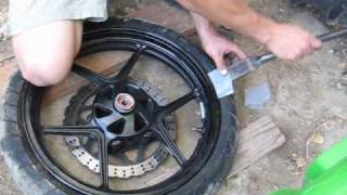 How to change a motorcycle tire without a stand or specialized tools