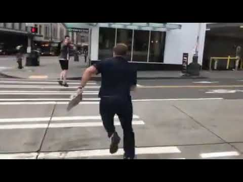 Alex Jones Chases a Guy Across the Street