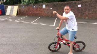 How to Safely Pull A Wheelie on a Child's BMX Bike