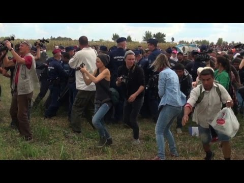 Hungarian TV camerawoman fired for kicking fleeing migrants thumbnail