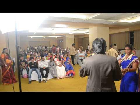 Magician Sudhakar Entertaining Audience.