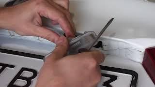 Как поменять лампочку подсветки номера на kia rio