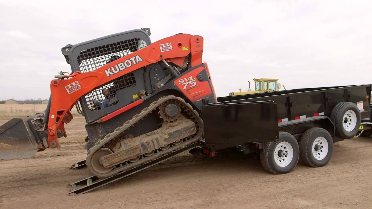 Unloading A Skid Steer Off The 14lx Youtube