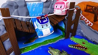 They are being chased by dinosaurs, crocodiles! Rescue the dangerous Robocar Poli. - DuDuPopTOY