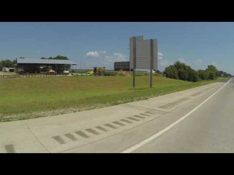Stevens Transport & Backward Signs along Interstate 40 in OK over Arkansas River Bridge GP040069