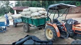 Tractor with a double trailer transporting upto 4 tonnes