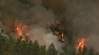 Wildfires rip across seven states in the West