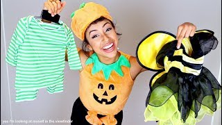 trying on baby costumes halloween fetus