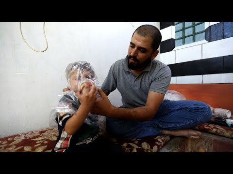 In Idlib, worried father turns paper cups into gas masks