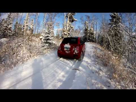 2012 fiat 500 driving out a steep icy drive way with 7 inches of fresh snow.