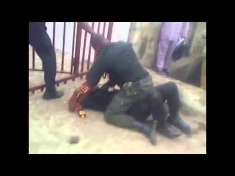 TWO NIGERIAN POLICE, FIGHTING EACH OTHER