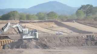 Liebherr 994 Excavator loading Cat 777 Dump Truck - Benga Mine