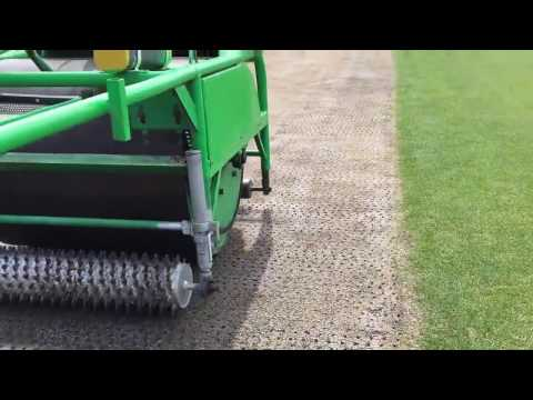 Seeding a used pitch in preparation for Aussie Rules at Blundstone Arena.