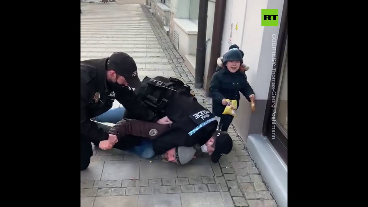 WATCH: Son Cries As Maskless Father Tackled By Police