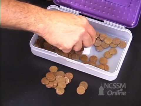 Penny Decay: Simulation of the First Order Kinetics of Radioactive Decay