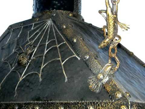 Из металла красивая кованая вытяжка для мангала в беседке для барбекю