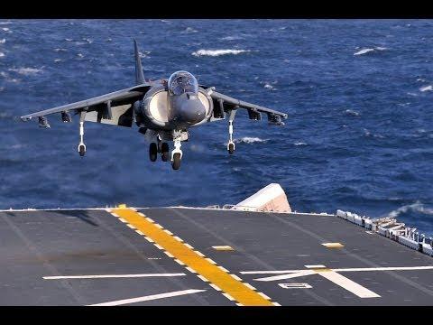 Harrier Jump Jet (nose) gear up landing on USS Bataan