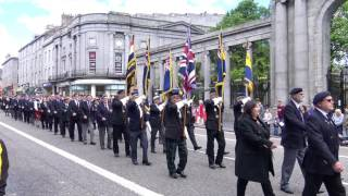 The massed pipe bands of North East Scotland lead the military para...