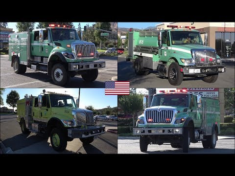 Forest fire trucks responding + general activity during large wildfire