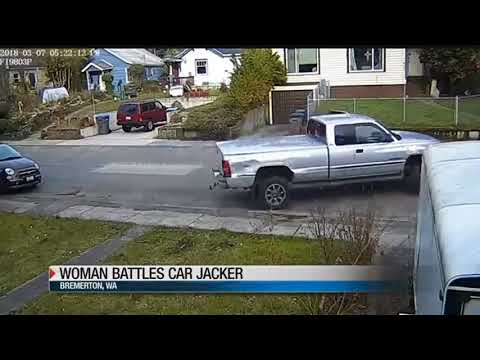 Caught on Camera: woman fights off car carjacker to save her child