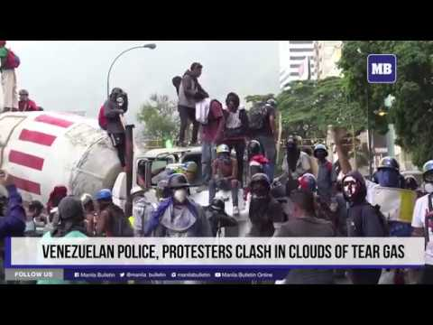 Venezuelan police, protesters clash in clouds of tear gas