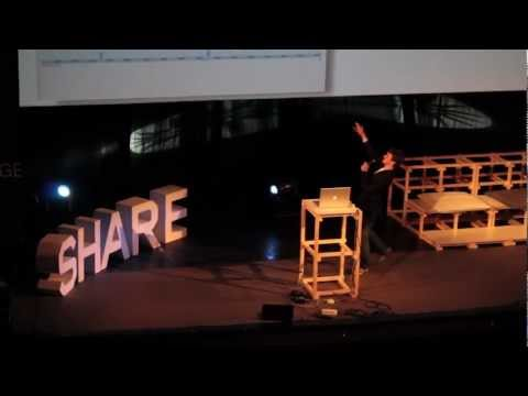 George Hotz performing about legal clash with Sony during Share2Conference