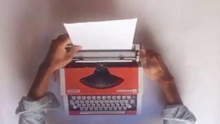 Olympia Traveller de Luxe Red Typewriter - VidalandYou