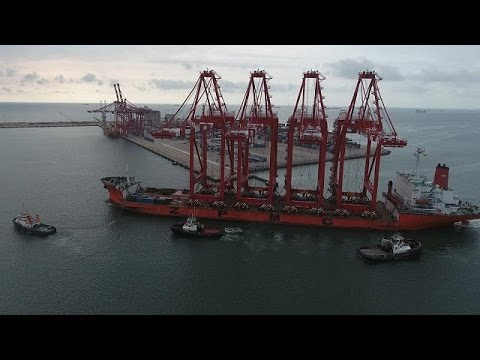 Giant cranes undocking at the port of Pointe-Noire in Congo [no comment]