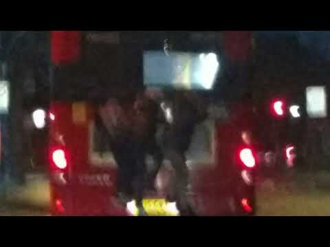 Children hanging on the back of a moving London bus branded 'reckless'