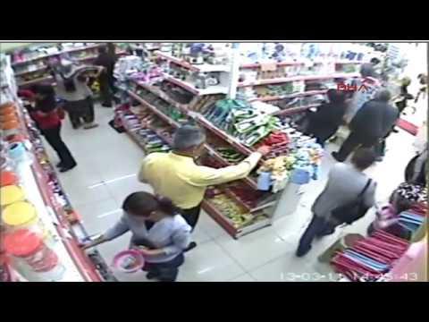 Markette taciz kameralara yakalandı