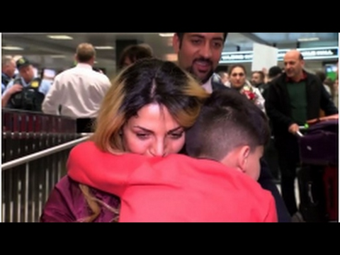 0d4619e9f3d94 Mother reunited with son at Washington airport after travel ban ...