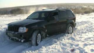 Jeep Grand Cherokee in snow off road