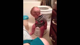 Trying out the potty chair
