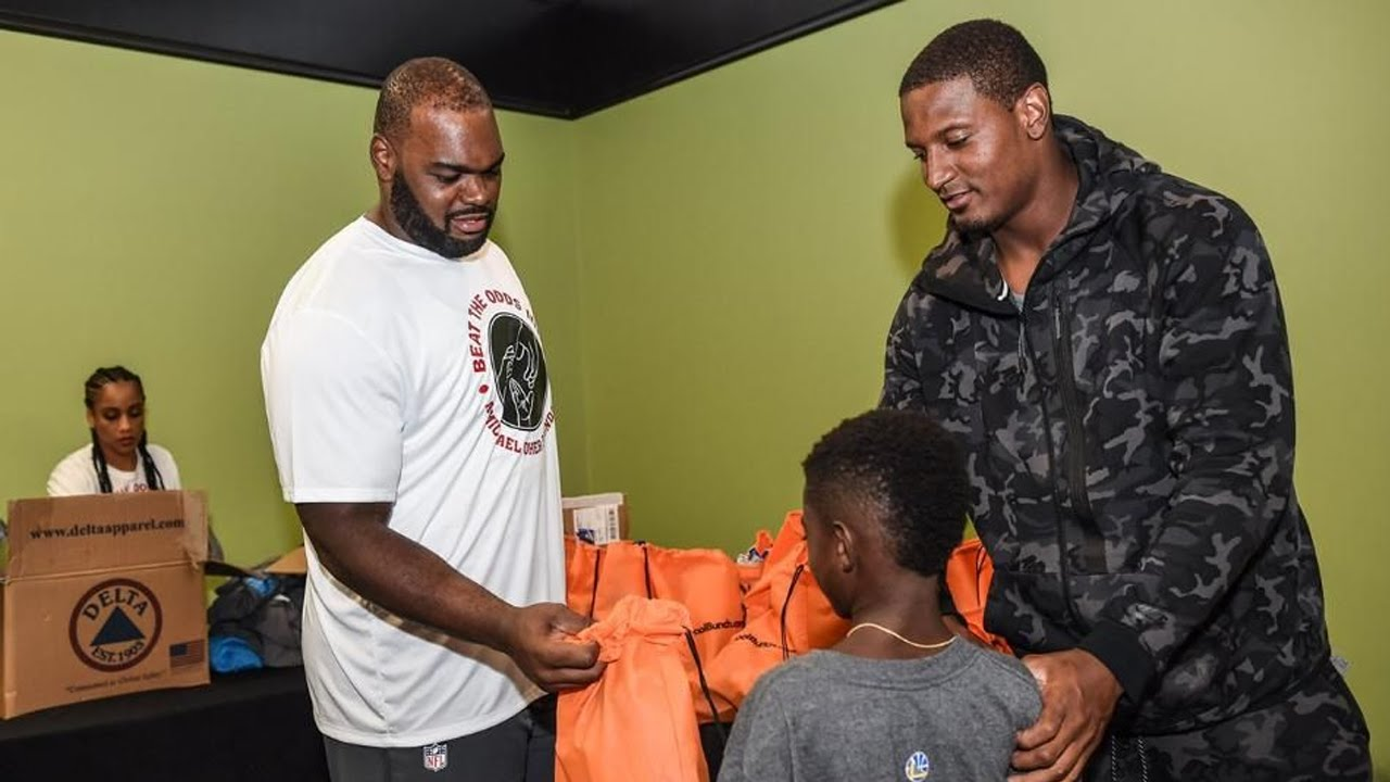 16df60071 Michael Oher hosts back to school party. Carolina Panthers