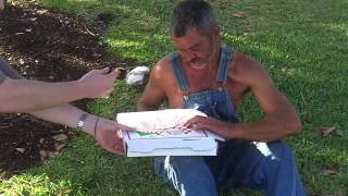Giving pizza to homeless people in Miami