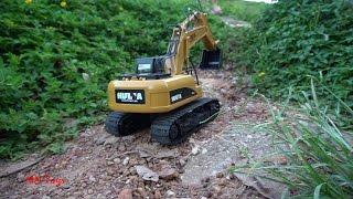 RC excavator Hulna 350 Đồ chơi xe máy xúc điều khiển từ xa leo dốc vượt chướng ngại vật MN Toys