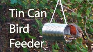 How to make a bird feeder out of a tin can. Nice way to recycle a food can and turn it into something useful. Fill it with seed and