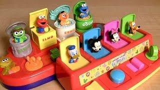 Mickey Mouse Pop-Up Surprise Pals Disney Baby Toys vs. Sesame Street Elmo, Oscar, Cookie Monster