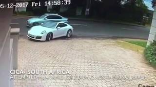 Another angle on the quick thinking Porsche driver who outwitted an armed hijacker in Johannesburg