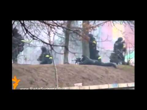 Riot police and a sniper filmed opening fire at protesters in Kiev