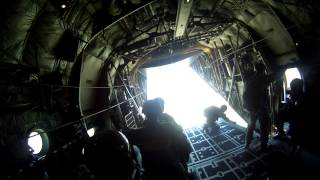 Static Line parachute jump out of a C-130.