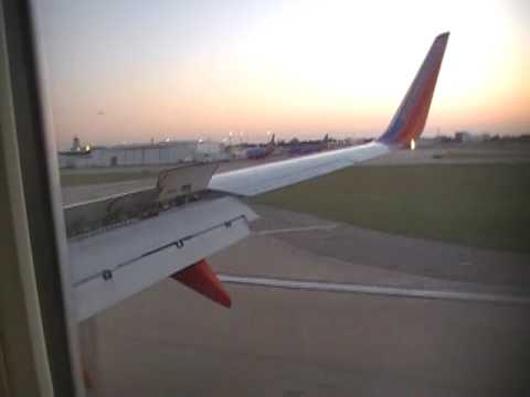 Southwest Airlines Flying into Dallas Love Field Sunset
