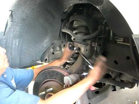HOW TO REMOVE FRONT STRUT ON FORD EXPEDITION ( EXPLORER
