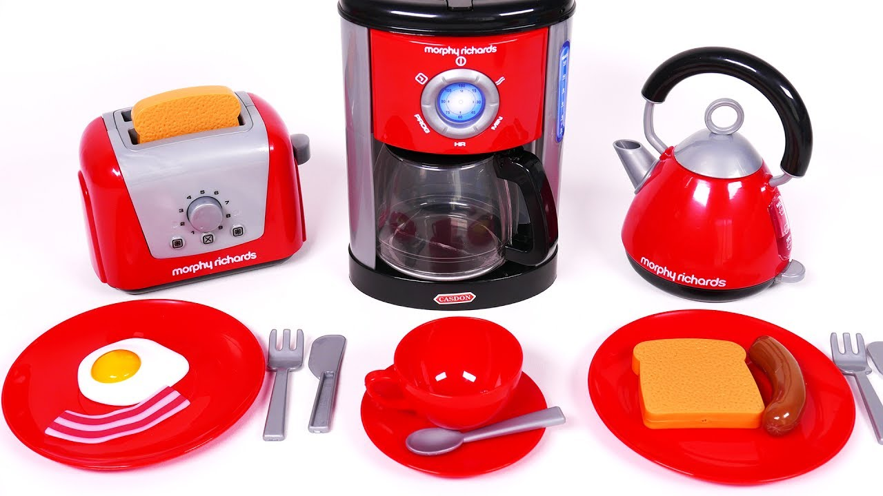 Cooking Breakfast With Coffee Machine Toaster And Kettle