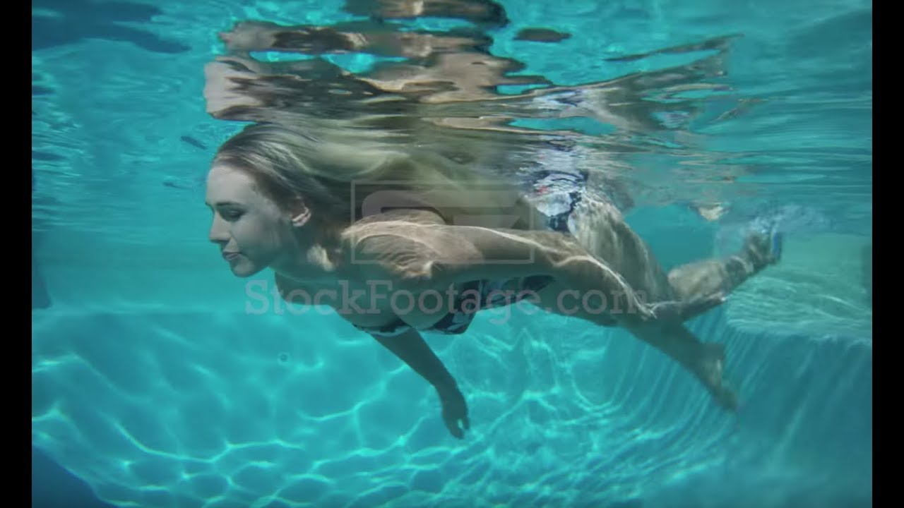 Woman swimming underwater stock footage - YouTube