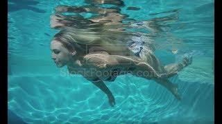 Woman swimming underwater stock footage