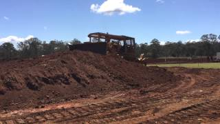 2015 Kingaroy vintage machinery show. Large CAT D9E playing in the dirt....