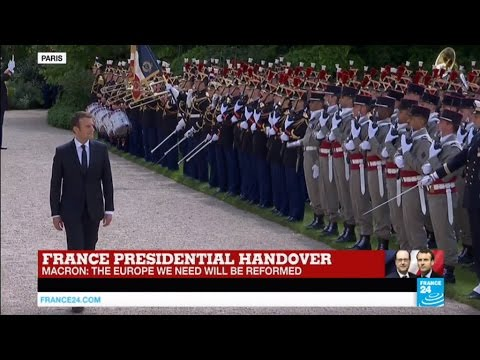 Macron inspects the Republican guard, under the sound of La Marseillaise and a 21-gun salute