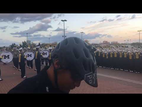 The Michigan band enters Michigan Stadium ahead of rivalry matchup against Michigan State