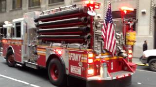 FDNY ENGINE 1 RETURNING TO QUARTERS ON WEST 31ST STREET IN MIDTOWN, MANHATTAN IN NEW YORK CITY.